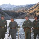 Soldiers, a lake and Mt Krn (Monte Nero) far behind