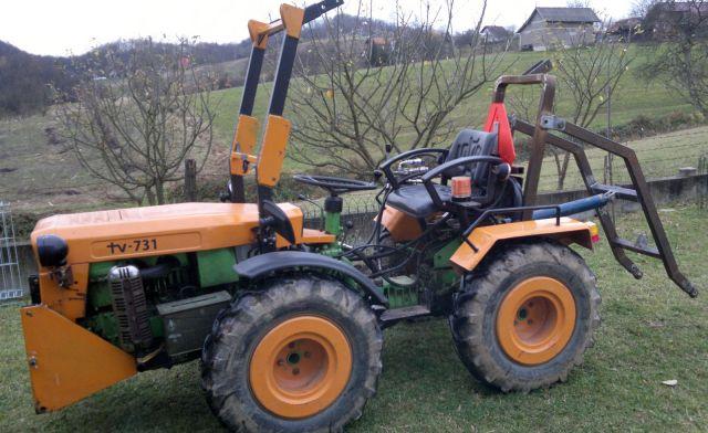 Zadnji traktorski utovarivač - Page 3 23413971