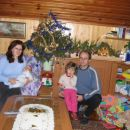 Family gathered at Christmas Tree