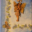 Platno s servetkom, stoječa cvetna vila - spominčica ja 3D tehnika, metuljčica spodaj je s